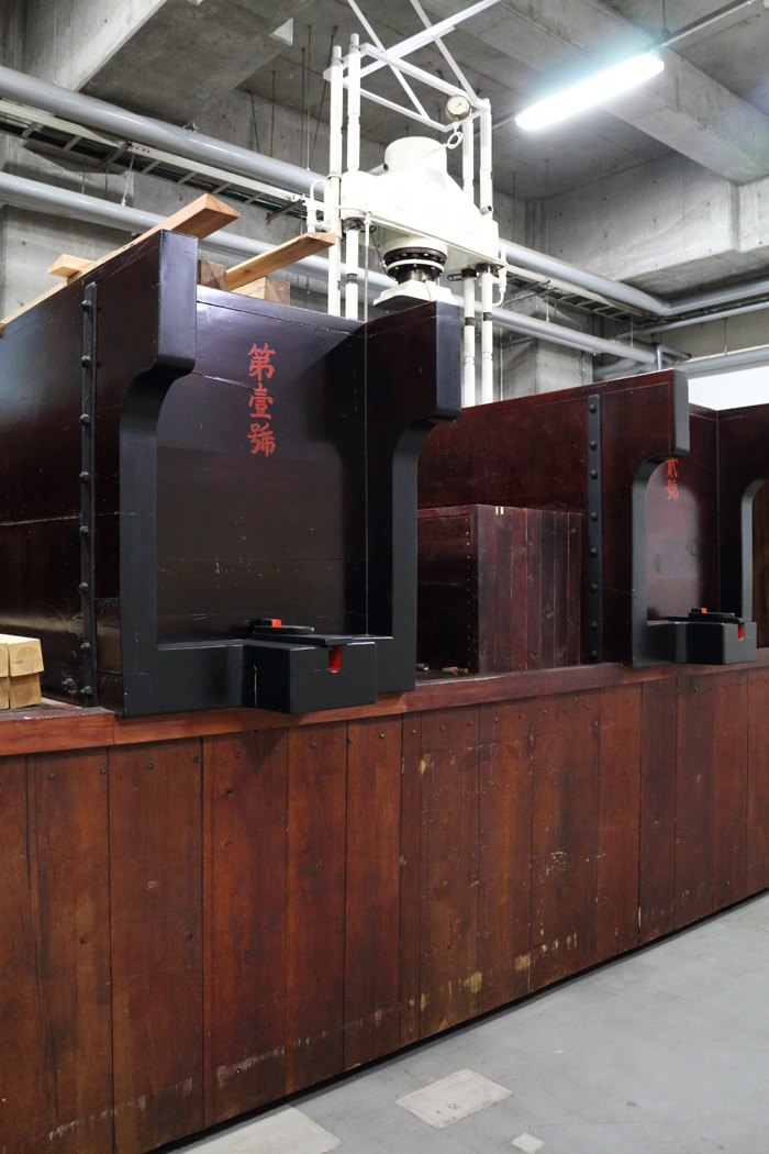 """Wooden box presses, known as """"kibune"""" in the Daishichi brewery. A method of separating the completed sake from the fermented rice solids that leads to extravagant sake."""