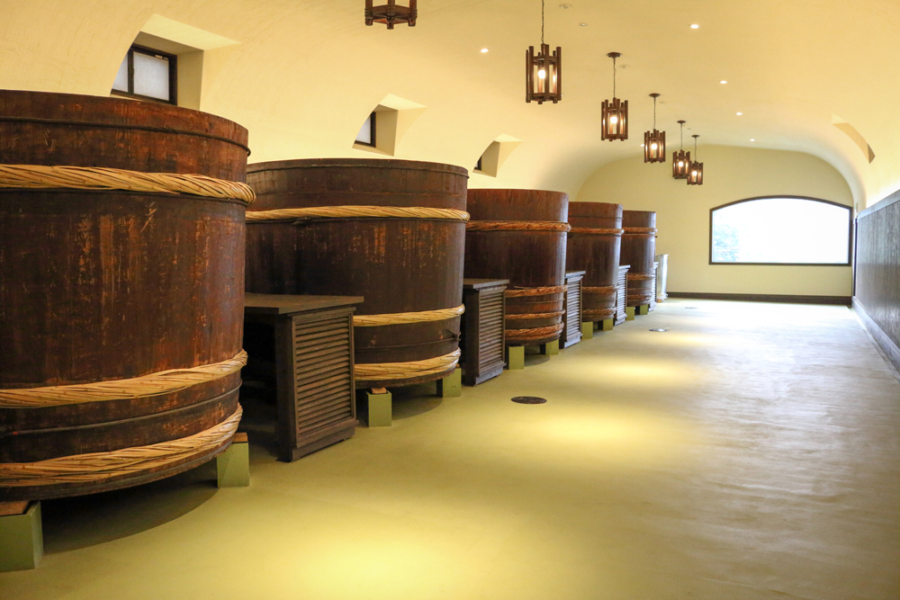 "Wooden tanks like these, known as ""ki-oke,"" were the norm until the 1940s. Daishichi makes several batches a year in these traditional fermentation tanks."